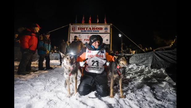 2021 IDITAROD CHAMPION— Not under the burled arch in Nome, but at Deshka Landing, Dallas Seavey and his lead dogs enjoy their 2021 Iditarod victory, in the early morning hours of Monday, March 15.