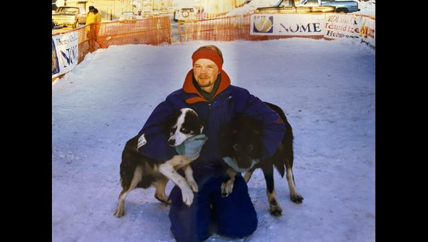 Aaron Burmeister and his dog Rocky, at the Iditarod finishline in 1996.